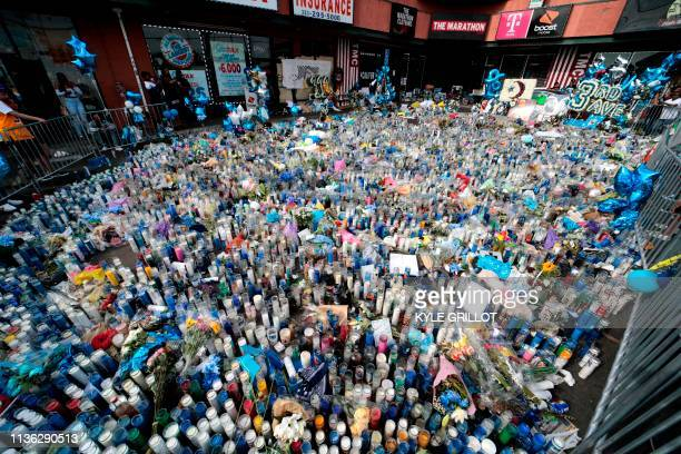 TOPSHOT A makeshift to rapper Nipsey Hussle Fans in front of his The Marathon clothing store in Los Angeles on April 11 2019 Hussle was shot dead...