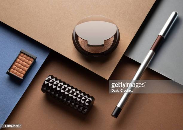 makeup and beauty products on color paper - still life foto e immagini stock