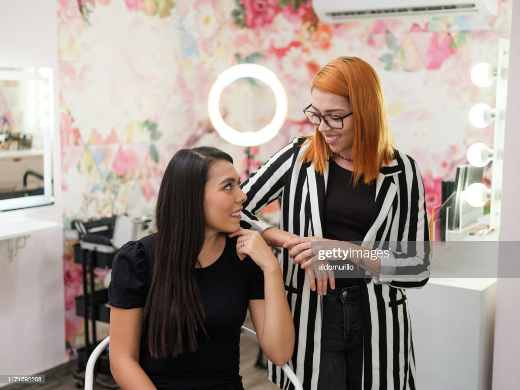 Makeup Artist And Employee Smiling At Each Other In Beauty Salon High Res Stock Photo Getty Images