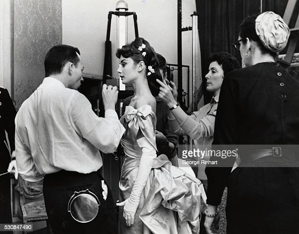 Makeup artist and hairstylists prepare Audrey Hepburn for a scene in Mayerling