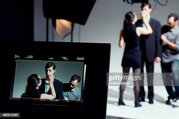 makeup artist and stylist working on model - stage set stock pictures, royalty-free photos & images