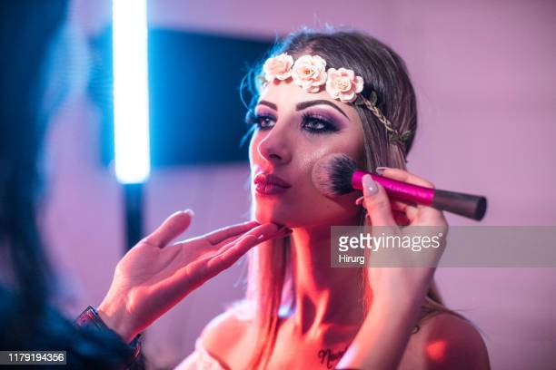 makeup artist applying blush - highlights stock pictures, royalty-free photos & images