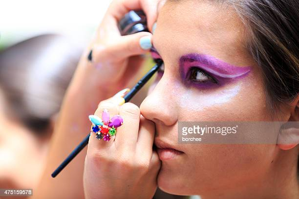 Makeup Artist Applying Eye Makeup With A Brush