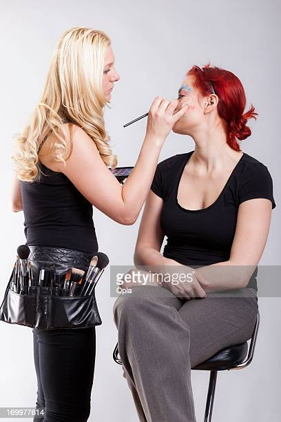 Makeup artist applying make-up