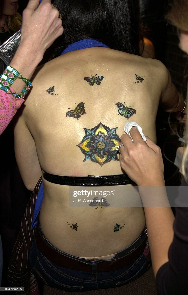 b5369764a4f5f Make-up Artist applying temporary tattoos during Rose DeMann Fashion ...