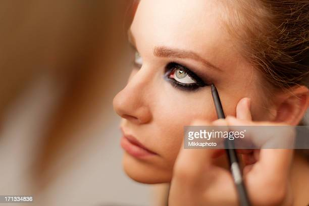 make-up artist at work. - eye liner stock photos and pictures