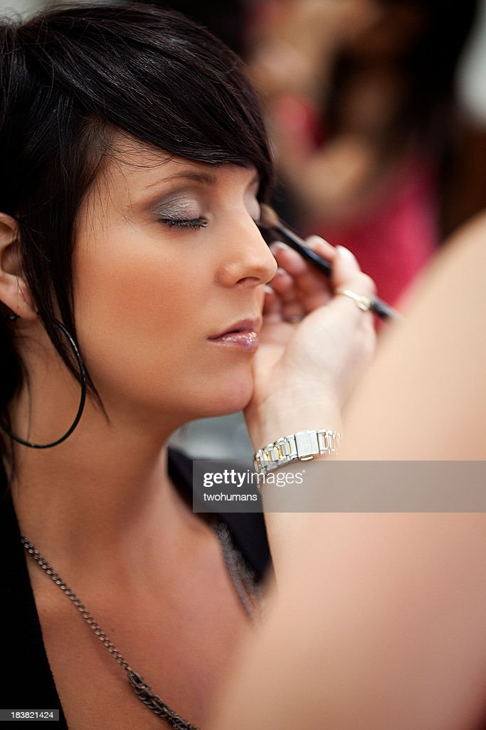 Make-up artist at work : Stock Photo