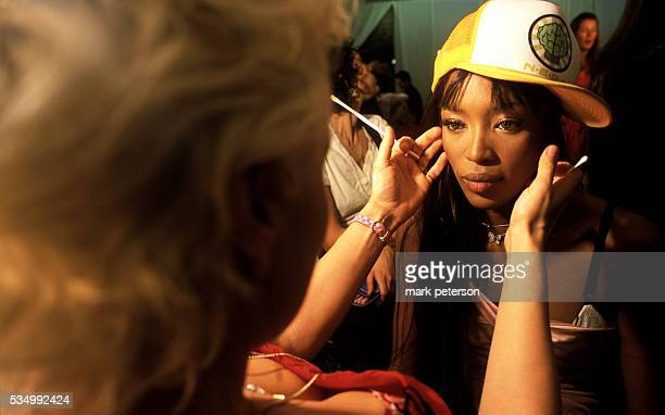 Makeup artist Charlie Green applies makeup to top model Naomi Campbell prior to the 8th Annual Victoria's Secret Fashion Show Photo by Mark...