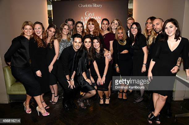 Makeup artist Charlotte Tilbury poses with her team during Charlotte Tilbury Arrives In America VIP Beauty Launch event presented by Bergdorf Goodman...