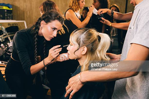 MakeUp Artist Coline Hamel and a Model poses prior the Tsumori Chisato Presentation as part of the Paris Fashion Week Womenswear Spring/Summer 2017...