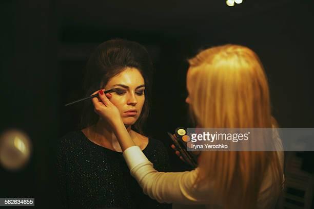 Make-up artist creates make-up for retro shoot