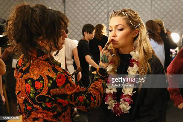 Makeup artist Erin Parsons and model Gigi Hadid is prepared backstage at Anna Su Spring 2016 during New York Fashion Week The Shows at The Arc...