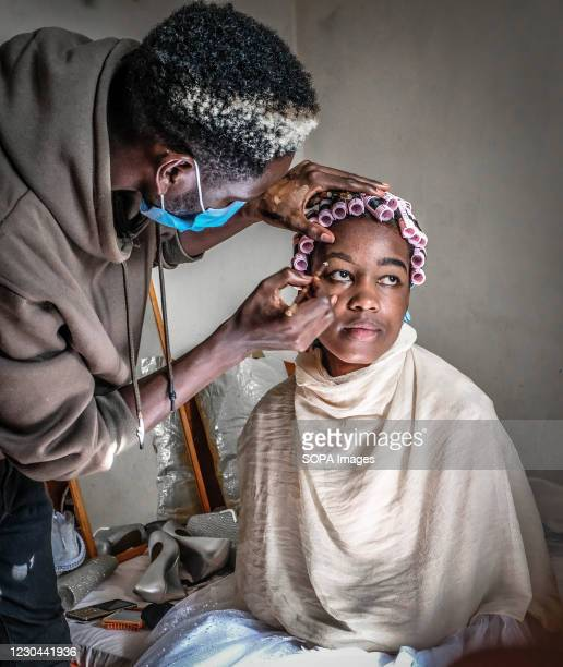 Make-up artist is seen preparing Mrs Perpetua Wanjiru for her special day. Due to social distancing and Covid-19 rules, weddings are now much smaller...
