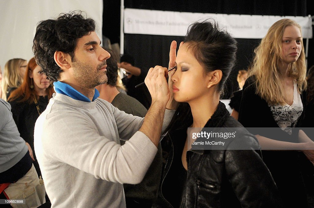 Makeup Artist James Kaliardos prepares a model backstage at the Lacoste Fashion Show during Mercedes-Benz Fashion Week Fall 2010 at Bryant Park on February 13, 2010 in New York City.
