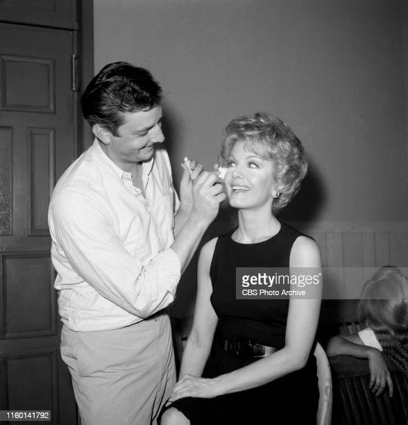 Makeup artist John Jiras is photographed behind the scenes with star Joanna Barnes on the set of the CBS television legal drama The Trials of O'Brien...