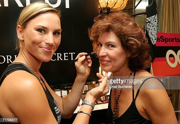 Makeup artist Naomi LowdePriestley applies makeup to actress Trisha Simmons at the Secret Very Sexy Makeup booth as she attends the Emmy 'Hearts On...