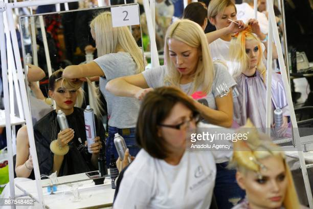 A makeup artist performs during the annual InterCHARM 2017 International Perfumery and Cosmetics Exhibition in Moscow Russia on October 28 2017