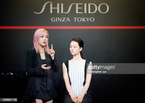 Makeup artist Pony creates a makeup look on model Elena An during Shiseido Masterclass with Pony on August 1 2018 in Tokyo Japan