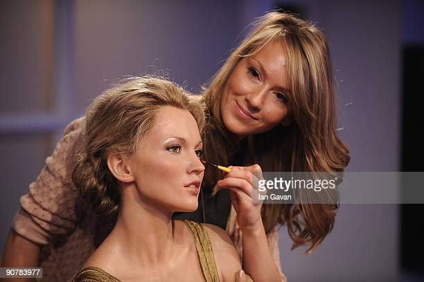 A makeup artist prepares a Kate Moss waxwork at Madame Tussauds on September 15 2009 in London England