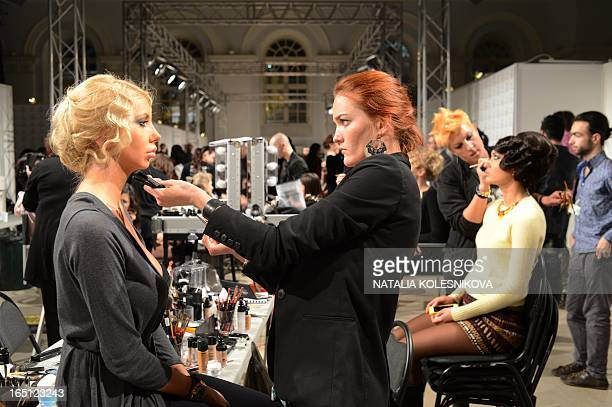 A makeup artist prepares a model backstage during the Russian Fashion Week in Moscow on March 31 2013 The Russian Fashion Week takes place from March...