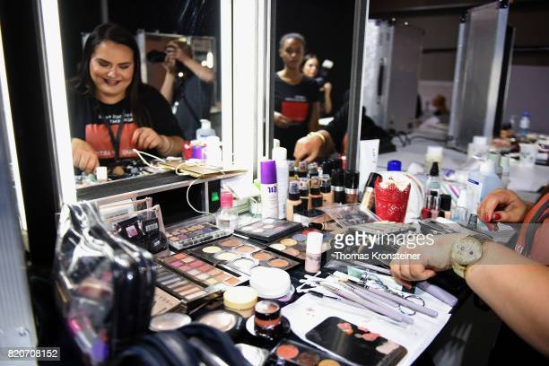 A makeup artist prepares backstage ahead of the 3D Fashion Presented By Lexus/Voxelworld show during Platform Fashion July 2017 at Areal Boehler on...