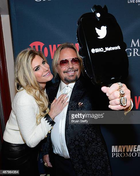 Makeup artist Rain Hannah and singer Vince Neil of Motley Crue pose for a selfie as they arrive at the VIP PreFight Party for 'High Stakes Mayweather...