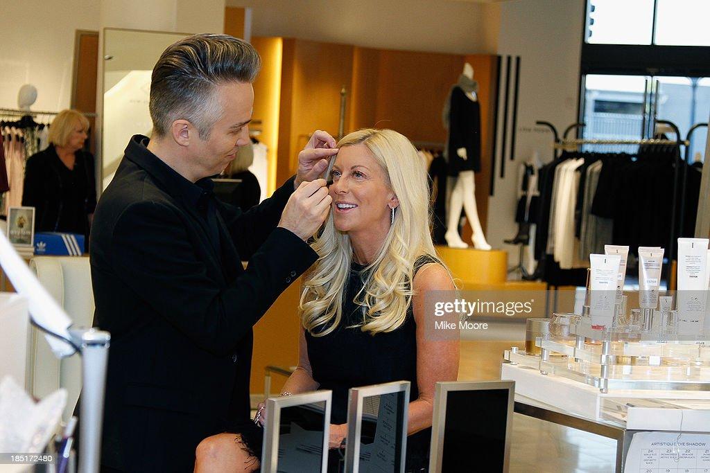 Makeup artist Troy Surratt applies Renee Parsons makeup during the