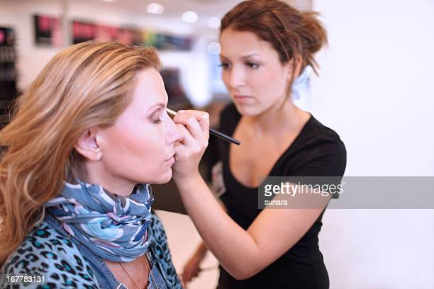 Make-up artist using a brush on a client