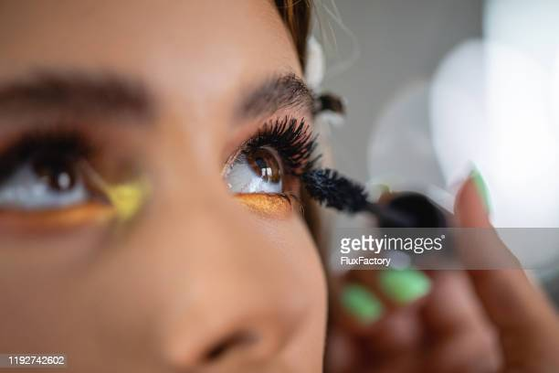 make-up artist using mascara on a customer - eyeshadow stock pictures, royalty-free photos & images