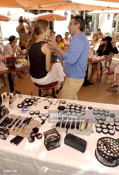 Makeup artist Vincent Longo makes up Lauren Bush prior to the Vincent Longo 5th Anniversary celebration benefiting amFAR and Sabera sponsored by KTV
