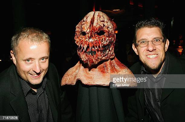 Makeup artists Gary Tunnicliffe and Mike Regan pose with a creature mask from the movie 'Feast' during the after party at the Little Buddha...