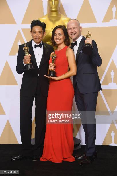 Makeup artists Kazuhiro Tsuji Lucy Sibbick and David Malinowski winners of the Best Makeup and Hairstyling award for 'Darkest Hour' pose in the press...