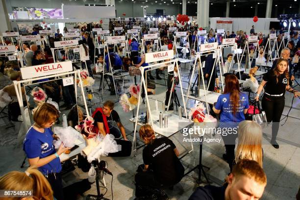 Makeup artists perform during the annual InterCHARM 2017 International Perfumery and Cosmetics Exhibition in Moscow Russia on October 28 2017