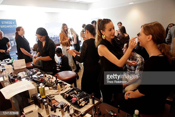 Makeup artists work on models at TRESemme at Imitation Spring 2012 Presentation at W Union Square on September 8 2011 in New York City
