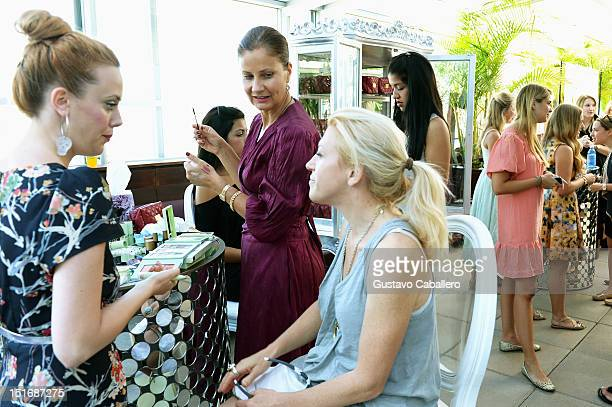 Makeup artists work the Clos du Bois At The Daily Style Sessions At the Empire Hotel Rooftop on September 9 2012 in New York City