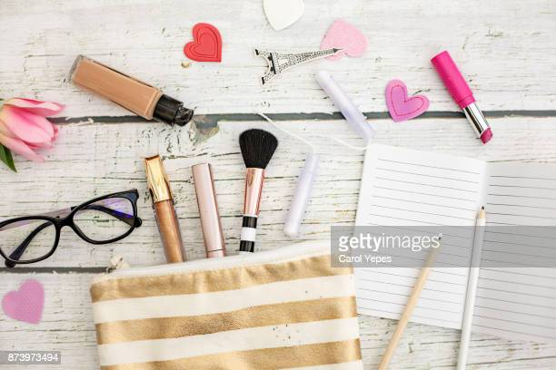 makeup bag - pink lipstick stock photos and pictures