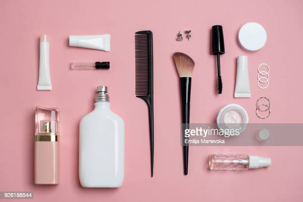 makeup bag with variety of beauty products - jewellery products stock photos and pictures