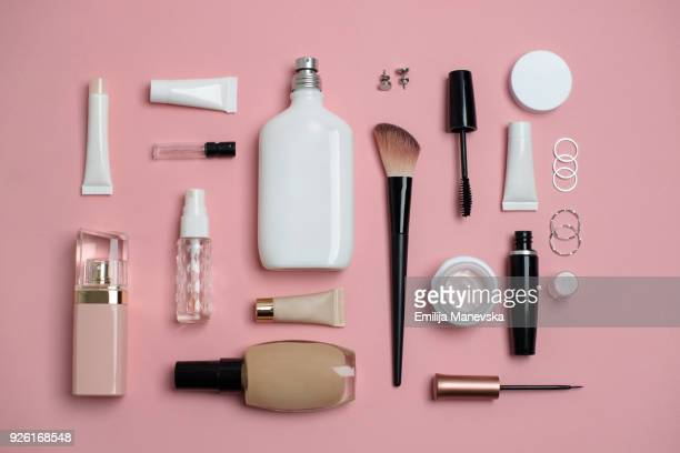 makeup bag with variety of beauty products - flat lay stock pictures, royalty-free photos & images