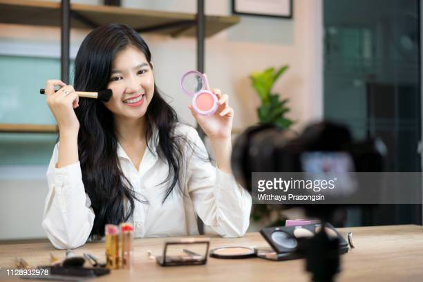 make-up. beauty blogger at work - tutorial stock pictures, royalty-free photos & images