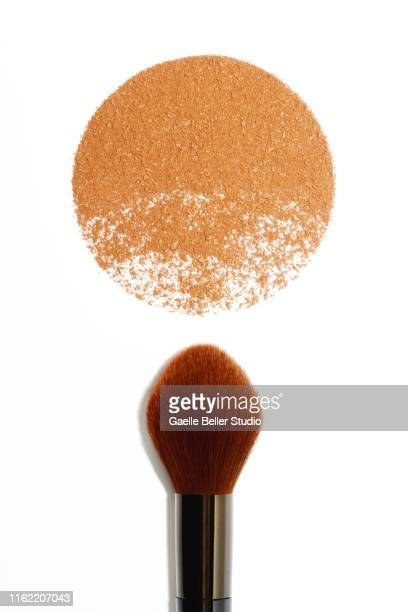 make-up brush and circle of bronzer powder - blusher stock pictures, royalty-free photos & images