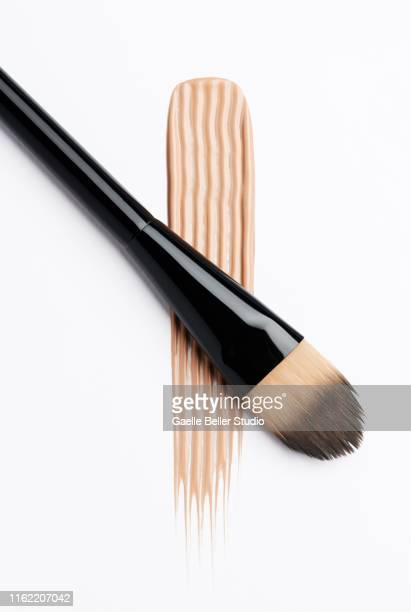 make-up brush and textured stroke of color - concealer stock pictures, royalty-free photos & images