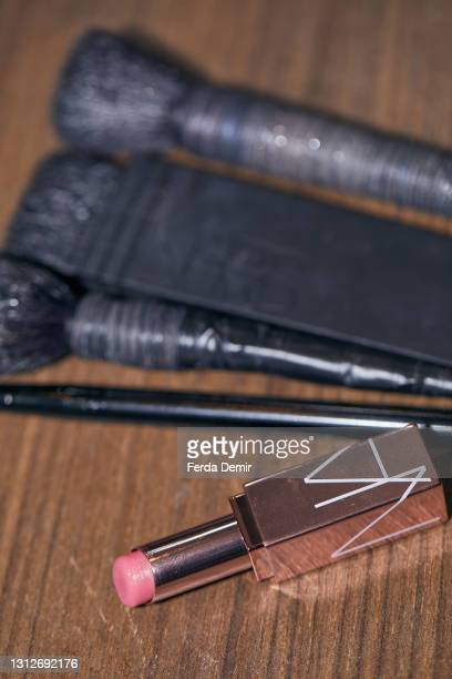 Makeup brushes and lipstick seen backstage ahead of the Cihan Nacar Lookbook for Istanbul Fashion Week on April 15, 2021 in Istanbul, Turkey.