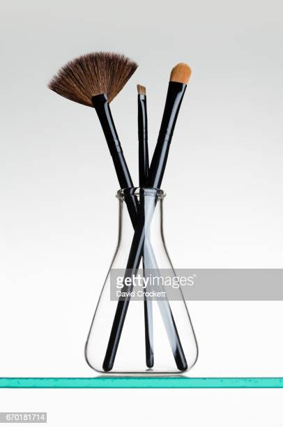 Makeup brushes in a flask
