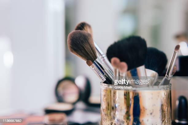 Make-up brushes in artist studio.