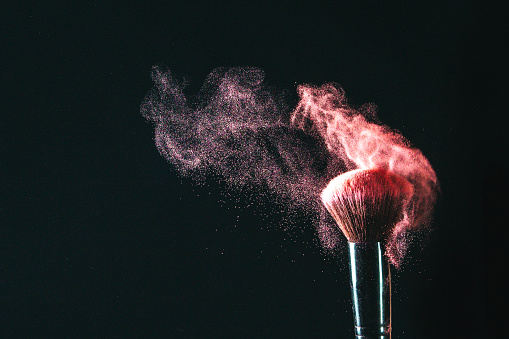 Makeup brushes on black background 1093145614