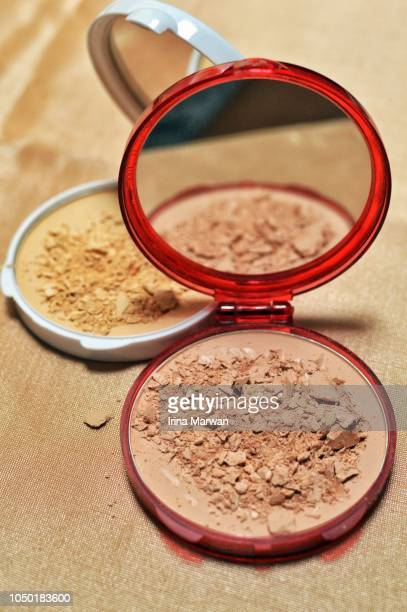 make-up: compact powder - concealer stock photos and pictures