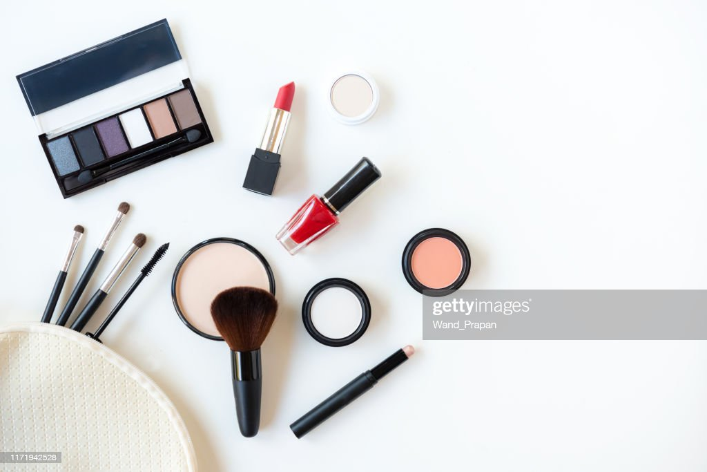 Makeup cosmetics tools background and beauty cosmetics, products and facial cosmetics package lipstick, eye shadow on the white background. Lifestyle Fashion Concept : Stock Photo