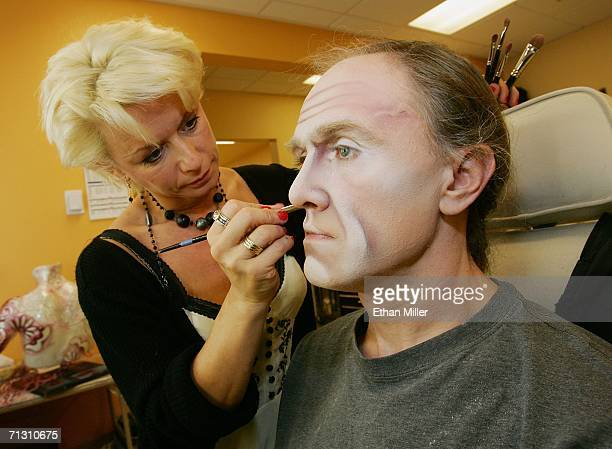 Makeup designer Nathalie Gagne applies makeup to actor Eugen Brim during a behindthescenes tour of 'The Beatles LOVE by Cirque du Soleil' at The...