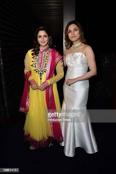 Makeup expert Aashmeen Munjaal with actor Nagma during unveiling of Regal Couture Collection and MakeUp Trends 2013 by Designer Preeti Ghai and...