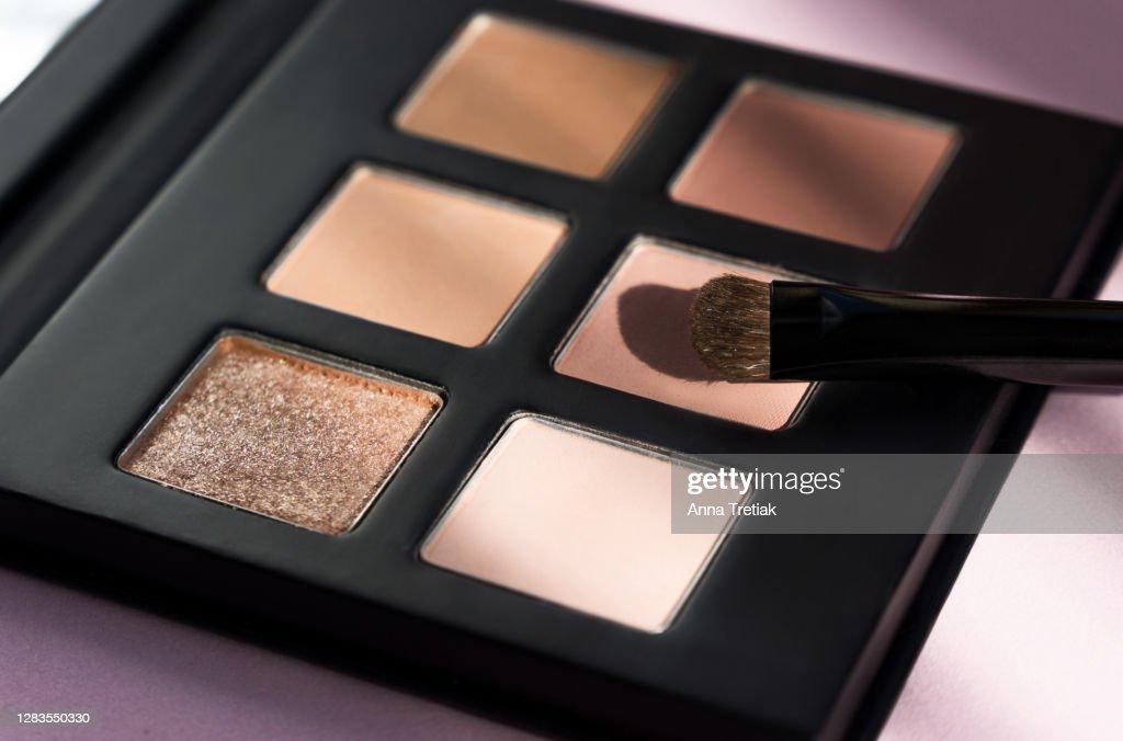 Makeup eyeshadow palette set. Trendy eyeshadow makeup palette background, eyeshadow brush close-up. Eyeshadow background. : Stock Photo